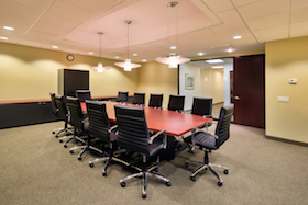 Liberty Meeting Room seats 18 people and includes television, Internet, conference calling