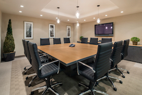 Grand Central Meeting Room accommodates 15 people and includes a television, Internet